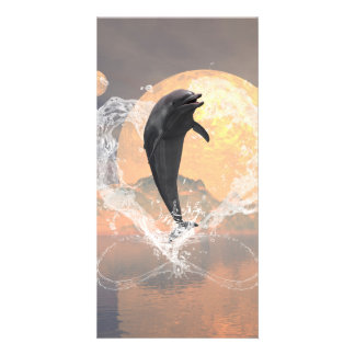 Dolphin jumping out of a heart made of water photo card