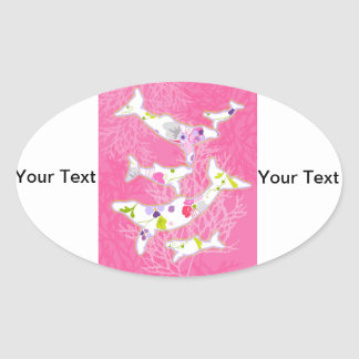 Dolphins on floral pink background. oval sticker