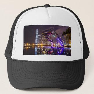Dolphins on Urban Background Landscape Trucker Hat