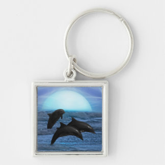 Dolphins playing at moonlight keychain