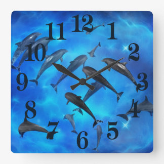 Dolphins swimming in the ocean square wall clock