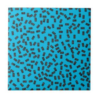 Dominoes on Blue Tile
