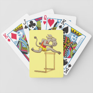 Donkey running and jumping over a hurdle poker deck