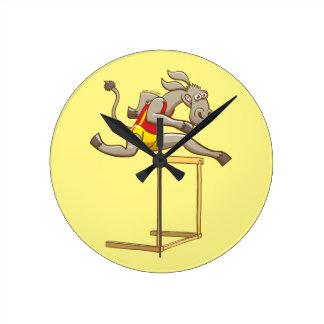 Donkey running and jumping over a hurdle wall clocks