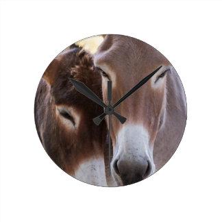 donkeys grazing wall clocks
