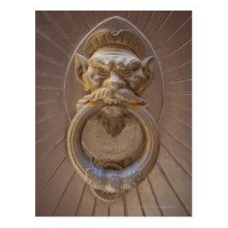 Door knocker in Siena, Italy. Postcard