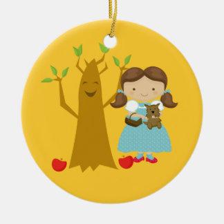 Dorothy next to Talking Tree Christmas Ornament