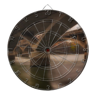 Double Crossing Dartboard With Darts