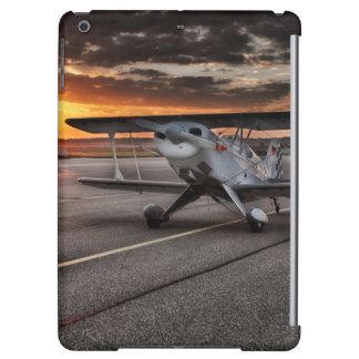 Double decker propeller plane on runway iPad air cases