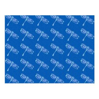 Dragonflies, pale blue on denim blue postcard