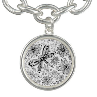 Dragonfly and flowers doodle charm bracelet