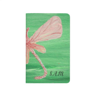 Dragonfly on Green Journal