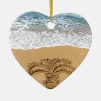 Drawing of palm tree on sandy beach ceramic heart ornament