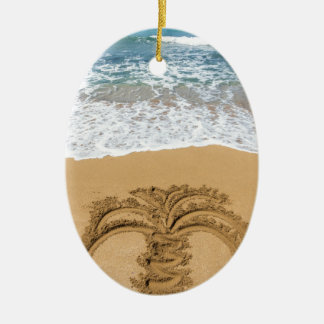 Drawing of palm tree on sandy beach ceramic oval ornament