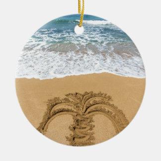 Drawing of palm tree on sandy beach round ceramic ornament