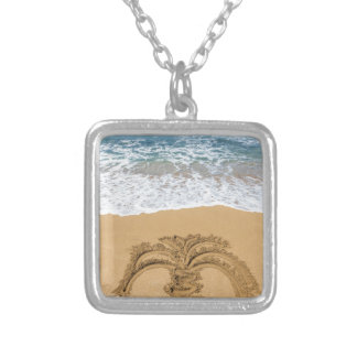 Drawing of palm tree on sandy beach silver plated necklace