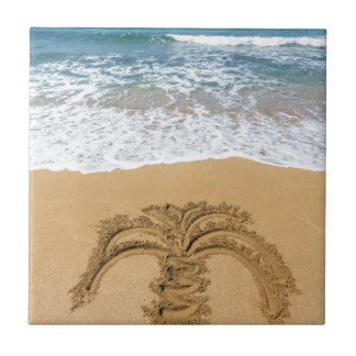 Drawing of palm tree on sandy beach tile