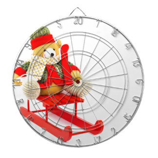 Dressed Christmas bear on red wooden sleigh Dartboard