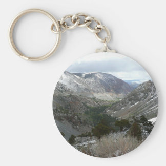 Driving Through the Snowy Sierra Nevada Mountains Basic Round Button Keychain