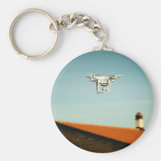 Dron above roofs keychain