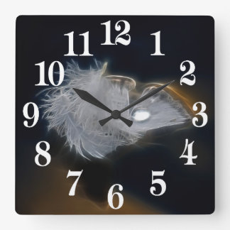 Droplet of water on a white feather square wall clock