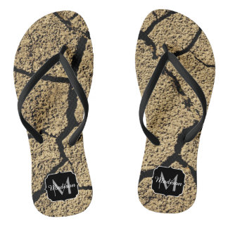 Dry land with cracked earth in drought Monogram Flip Flops