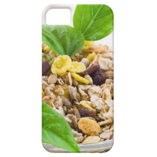Dry mix of muesli and cereal in a bowl of glass case for the iPhone 5