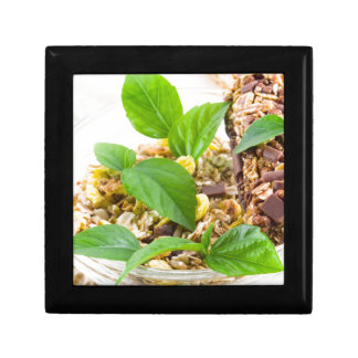 Dry mix of muesli and cereal in a bowl of glass gift box