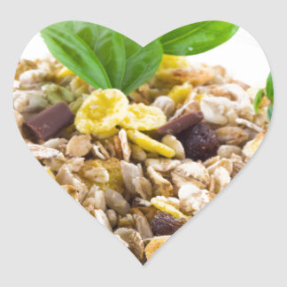 Dry mix of muesli and cereal in a bowl of glass heart sticker