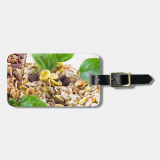 Dry mix of muesli and cereal in a bowl of glass luggage tag