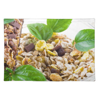 Dry mix of muesli and cereal in a bowl of glass placemat