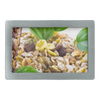 Dry mix of muesli and cereal in a bowl of glass rectangular belt buckle