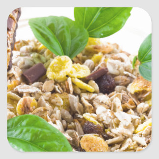 Dry mix of muesli and cereal in a bowl of glass square sticker