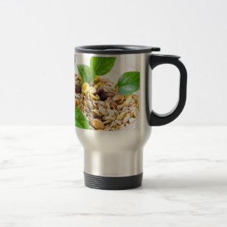 Dry mix of muesli and cereal in a bowl of glass travel mug