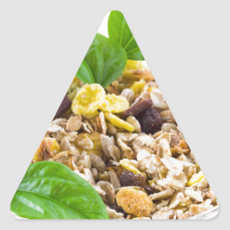 Dry mix of muesli and cereal in a bowl of glass triangle sticker