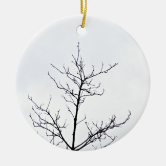 Dry tree branch against cloudy sky ceramic ornament