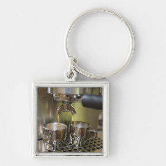 Dual espresso shots being brewed. Silver-Colored square keychain