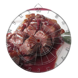 Duck breast on Sangiovese red wine sauce Dartboard