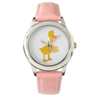 duck eating bread. wristwatch