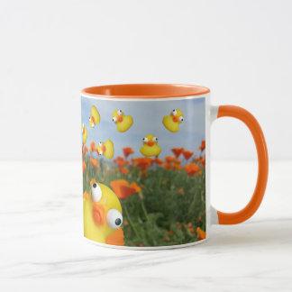 ducks bouncing in a meadow of poppy plants mug