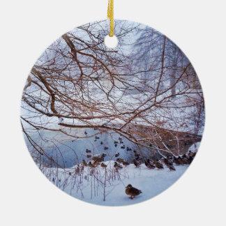 Ducks Gather Around A Frozen Pond Round Ceramic Ornament