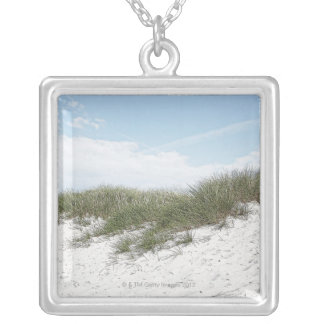 Dune at a beach in scandinavia. silver plated necklace
