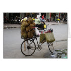Durian for sale on a bicycle card