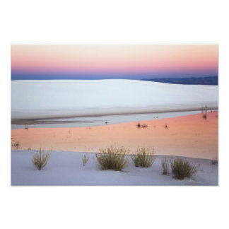 Dusk sky reflected in pool of water from photo print