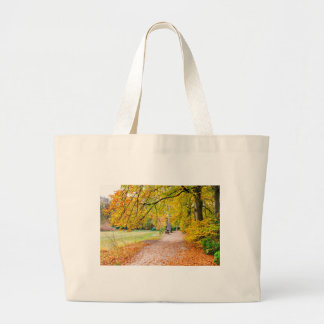 Dutch autumn landscape with footpath and tree large tote bag