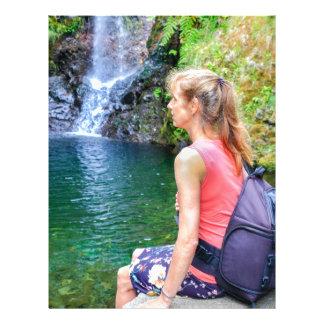 Dutch woman sitting on rock near waterfall letterhead