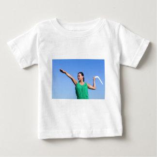 Dutch woman throwing boomerang in blue sky baby T-Shirt