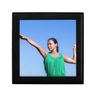Dutch woman throwing boomerang in blue sky gift box