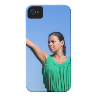 Dutch woman throwing boomerang in blue sky iPhone 4 cover