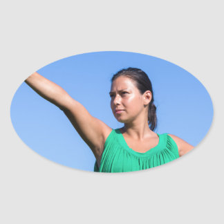 Dutch woman throwing boomerang in blue sky oval sticker
